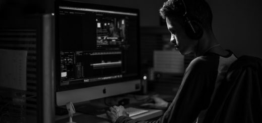 Man in raglan sleeve shirt using computer